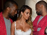 That perked him up! Sleepy Kanye West takes a nap during fiancee Kim Kardashian's birthday bash... but wakes up when he spies her ample cleavage