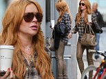 Lindsay Lohan in olive green trousers