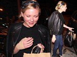 Any chance of dressing with that? Kirsten Dunst reveals a heavily bandaged hand as she steps out for dinner with Garrett Hedlund