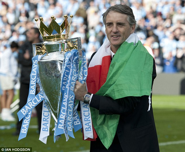 You're the one for me: Mancini with the prized Premier League trophy