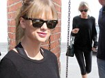 So that's how she gets her amazing body! Taylor Swift shimmies her svelte figure into a Ballet Bodies class