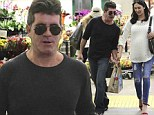 Domestic bliss! Simon Cowell insists on carrying the bags during grocery run with pregnant girlfriend Lauren Silverman