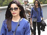 Tres jolie! Freida Pinto plays tourist with a starry twist in blue sweater and black leggings during stroll through Paris