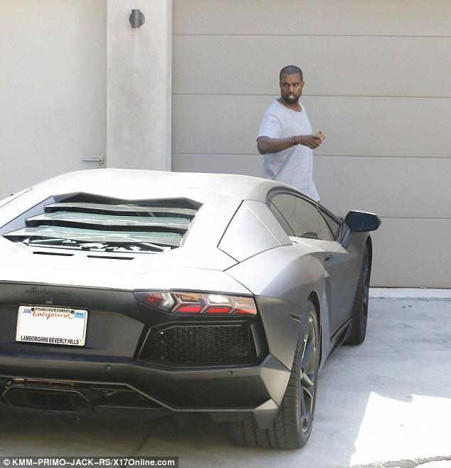 Expensive tastes: West then hopped into his sleek black Lamborghini