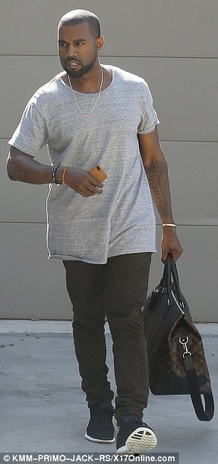 Home sweet home: The 36-year-old rapper accessorised his baby bling with a grey T-shirt, black skinny jeans, and matching high-tops