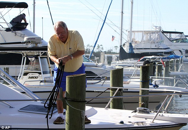 Batten down: Al Baumer of Madisonville, Louisiana unties his boat to take it out of the water before Tropical Storm Karen arrives at Point Cadet Marina in Biloxi, Mississippi