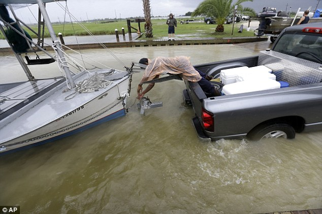 Preparation: C.J. Johnson pulls a shrimp boat out of the water in preparation for the arrival of Tropical Storm Karen, at Myrtle Grove Marina in Plaquemines Parish, Louisiana
