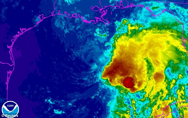 Weakening: Tropical Storm Karen is seen in a National Oceanic and Atmospheric Administration (NOAA) Geostationary Operational Environmental Satellite (GOES) East infrared enhanced satellite image taken at 21:45 EST October 4