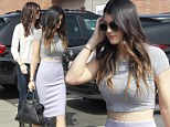 Kylie Jenner shows off her toned tummy as she gets back to business at a Los Angeles studio after slamming underage drinking rumours
