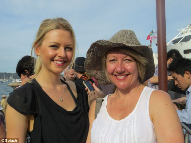 'Perfect gentleman': Lauren Burke, 22, left was weak at the knees when Harry picked up her mother Therese's hat while they stood in the crowd