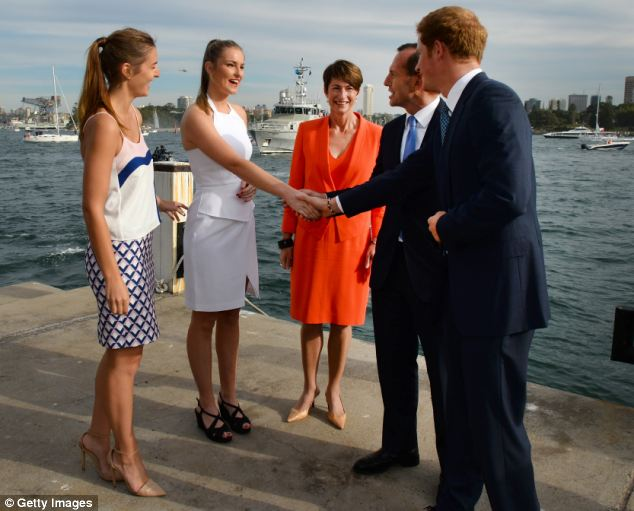 Meeting the family: Harry is introduced by Australia's Prime Minister Tony Abbott to his daughter Bridget, second left, as his wife Margie, centre, and daughter Francis, left, look on