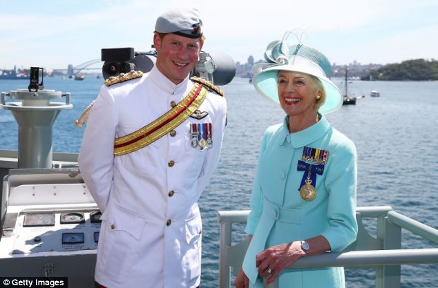 Official: Prince Harry and Governor-General Quentin Bryce pose onboard the HMAS Leeuwin