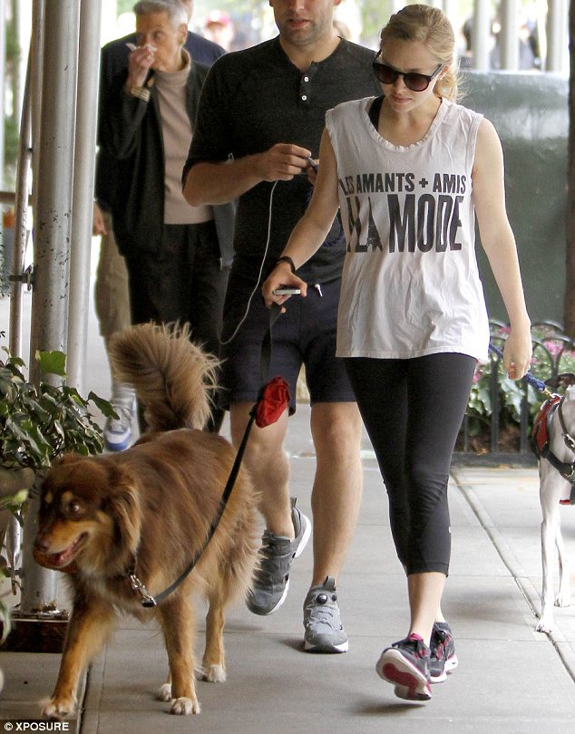 Best friends: Amanda Seyfried took her dog Finn for a walk after hitting the gym in New York on Friday