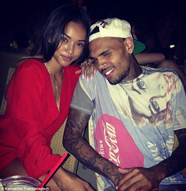 Starting young: Chris brown, seen here with his current girlfriend Karrueche Tran, has revealed he lost his virginity at eight years of age