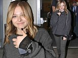 Chloe Moretz cuts a grungy figure in grey sweater and green jeans as she jets into Vancouver