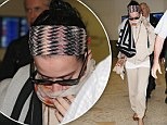 What a cover up! Katy Perry goes incognito in beige tracksuit and scarves as she arrives in Sydney for Australian X Factor appearance