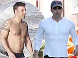 Someone's been working out! Ben Affleck shows of his impressive ripped body in clinging shirt as he bulks up to play Batman