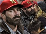 Bearded Jon Hamm silently cheers on the St Louis Cardinals at the World Series after undergoing surgery on his vocal chords