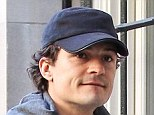 Is this the happiest they've been? Smiling Orlando Bloom visits Miranda Kerr for the THIRD day in a row despite split announcement