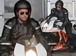 Spoilt for choice! Safety conscious Bradley Cooper zips around on two of his beloved motorbikes in one day