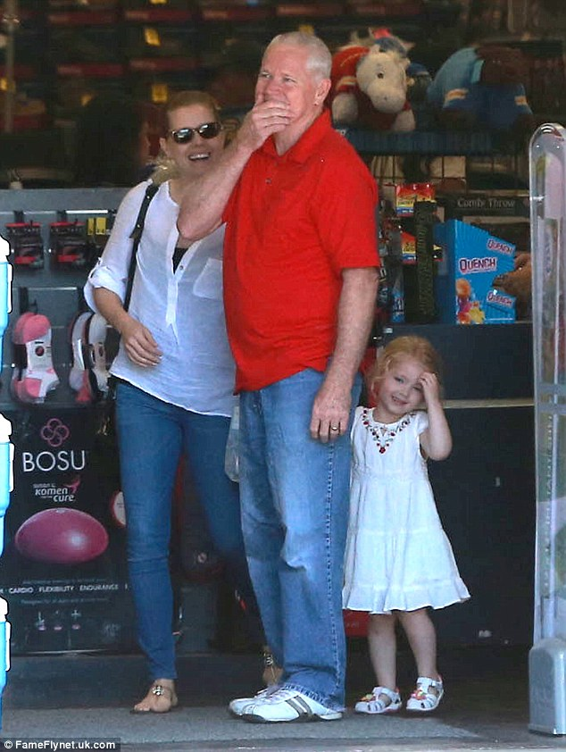 Barrels of laughs: The cute twosome shared a giggle as they left the store with an unidentified older male