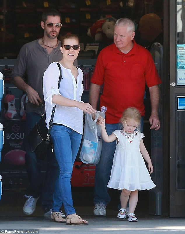 Family day: Amy, her fiancé and baby daddy Darren Le Gallo and Aviana headed out for a tasty breakfast before stopping by a Big 5 sporting goods store for supplies, with the tot looking sweet in her white summer dress
