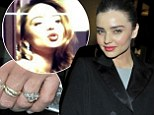 Flying solo: Miranda Kerr didn't appear to have a care in the world as she enjoyed a solo night out minus her wedding ring on Wednesday - just 24 hours before announcing her split from husband Orlando Bloom