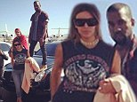 'We've arrived!' Kim Kardashian turns rock chick and Kanye West stands atop a flashy car as they hit Vegas for her birthday party