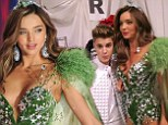 Bieber Fever: Justin Bieber ogles the Victoria's Secret supermodel Miranda Kerr back stage sending her husband Orlando Bloom crazy
