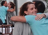 Who's that guy? Emma Watson gives a hug and a kiss to mystery man at dinner