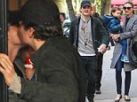 Is parting such sweet sorrow? Orlando Bloom kisses Miranda Kerr on the cheek after pair play happy families with Flynn following split announcement