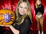 All that glitters is... Hilary Duff stood out in a pair of gold trousers to attend Just Jared's Halloween party at Beacher's Madhouse in Hollywood, California on Thursday