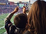 Patriotic: Gisele brought along her son Benjamin to watch his father Tom Brady play for the New England Patriots on Sunday