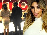 Movie date! After walking the red carpet, Kim Kardashian keeps her five inch heels and skintight dress on to take in Captain Phillips with fiance Kanye West