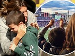 'Go Pats!' Gisele Bundchen perches her tot Benjamin on her knee as they watch his father Tom Brady play football... then tenderly hugs stepson Jack after game