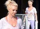 Britney Spears is lovely in lavender as she devotes another day of rehearsal at the dance studio