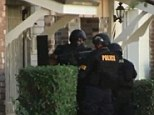 Heavy response: Phoenix SWAT police stormed Michael Dante Guzzo's apartment following the rampage - only to find him dead by his own hand