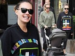 Showing her how it's done: Pregnant Tamara Ecclestone joins sister Petra and her daughter Lavinia for a walk