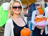 Her precious pumpkin! Holly Madison dressed her daughter Rainbow in a fitting costume for their trip to Mr. Bones Pumpkin Patch in West Hollywood, California on Friday