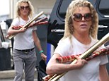 Christmas comes early for Kim Basinger as she loads SUV with wrapping paper while moving daughter Ireland out of the house