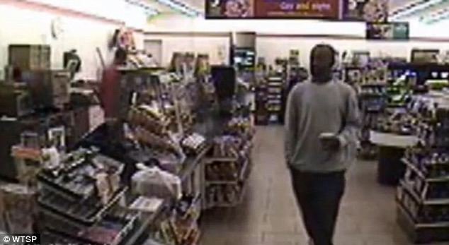 Setting the scene: This unidentified man approached the checkout counter on October 12 with coffee