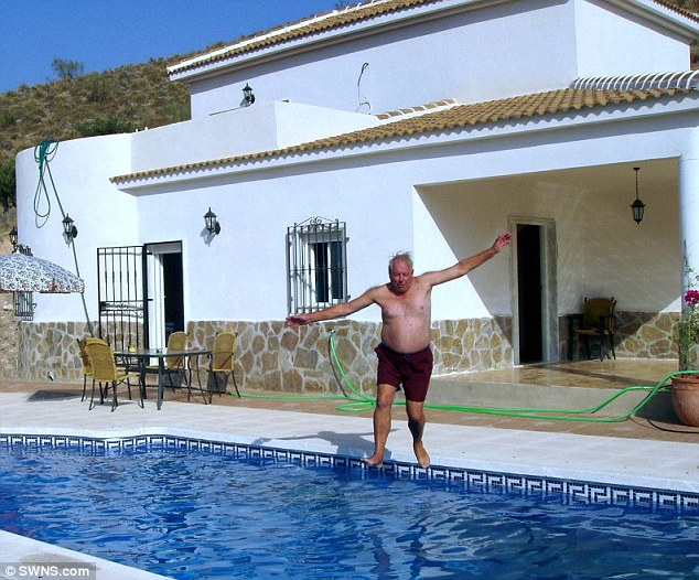 Splash: A man jumps into the swimming pool at the Spanish villa - but the property has now been destroyed after a court order