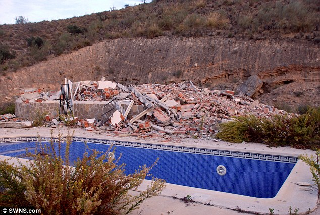 Poolside debris: The three-bedroom villa cost the British couple £150,000. Now they will have to try and recover their savings