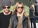 In this together: Ashley Tisdale and her fiancé Christopher French held hands as they looked at a possible home to purchase in Los Angeles, California on Sunday