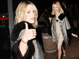 Thumbs up! Peaches Geldof wears a fur trim tweed coat in Dublin with husband Thomas Cohen