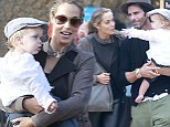 DWTS' Elizabeth Berkley gets plenty of exercise toting her son through a West Hollywood pumpkin patch Sunday