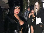 Happy Halloween: Fergie and Josh Duhamel pose for the cameras at Kate Hudson's Halloween party in Brentwood, CA