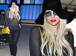 The Warrior is back! Ke$ha bares her bra at LAX after being banned from performing in Malaysia for 'reasons of religion and culture'