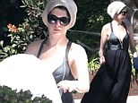 Maybe it's a costume? Anne Hathaway wears a favourite hat with a black maxi dress as she gets her house nice and spooky for Halloween