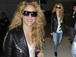 Shakira makes her way across LAX Airport in Los Angeles on Sunday
